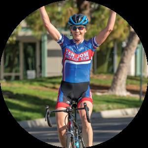 Bev Chaney crosses finish line bike race